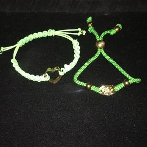 Two Juicy Couture adjustable woven bracelets